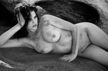 Model artistic nude figure study at the beach